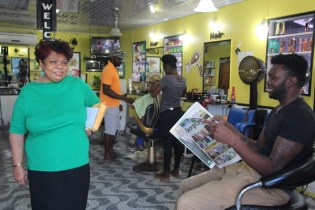 Persons flocked a popular barber shop on D'Urban Street as they raised several concerns.