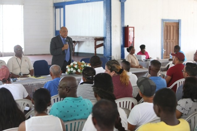 Minister of Natural Resources, Raphael Trotman addresses miners during the start of government's mining lottery.