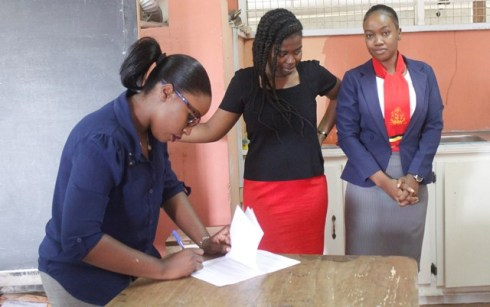 Quality Assurance Officer, Ms. Tiffany Roberts engaging teachers of the West Ruimveldt Secondary School in the school's laboratory.