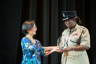 Deputy Police Commissioner, Maxine Graham receiving her award for her years of service in the Guyana Police Force.