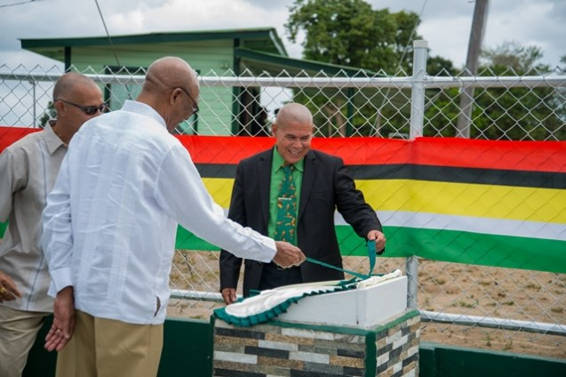 President David Granger as he unveils the plaque for the National Youth Corps along with Minister of Social Cohesion, Dr. George Norton.
