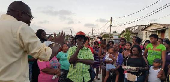 Minister of Public Infrastructure, David Patterson addressing concerns of residents in North Sophia.