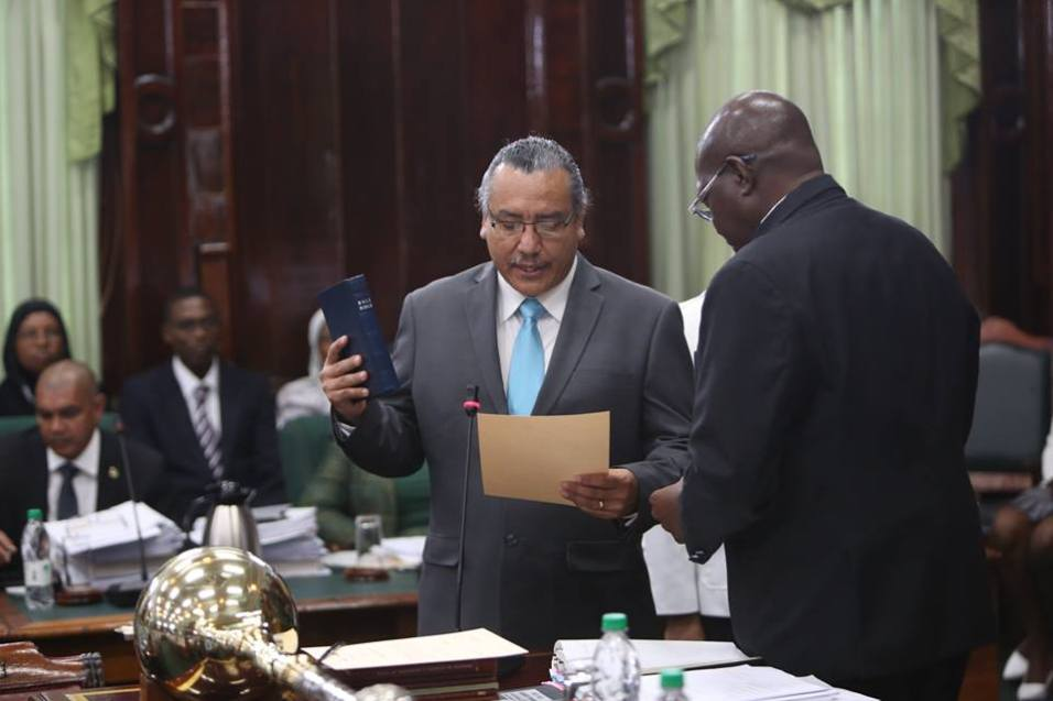 Mervin Williams as he in being sworn in as a Member of the National Parliament