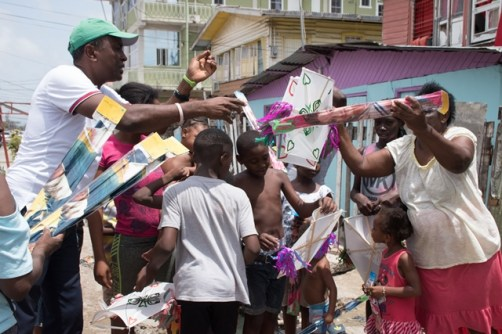 Deputy Mayor, Alfred Mentore along with his team distributing kites to the children in Campbellville Housing Scheme.