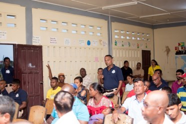 A member of the Number 63 Village Community Policing group makes a point during the Q&A session.