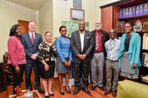 Minister of State, Mr. Joseph Harmon is flanked by, from left to right: Consultants, Dr. Zoikla Fletcher-Payton, Dr. Daniel Buss, Ms. Tamica Noel; Head of the Office of Climate Change, Ms. Janelle Christian; PAHO/WHO Senior Advisor, Environmental Health and Sustainability, Eng Adrianus Vlugman; PAHO/WHO, Country Representative, Dr. William Adu-Krow and Ministry of the Presidency Political Assistant, Ms. Tabitha Sarabo- Halley.