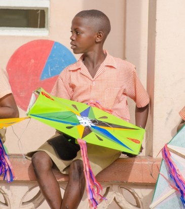 On of the lucky Enterprise Primary School students with his kite.