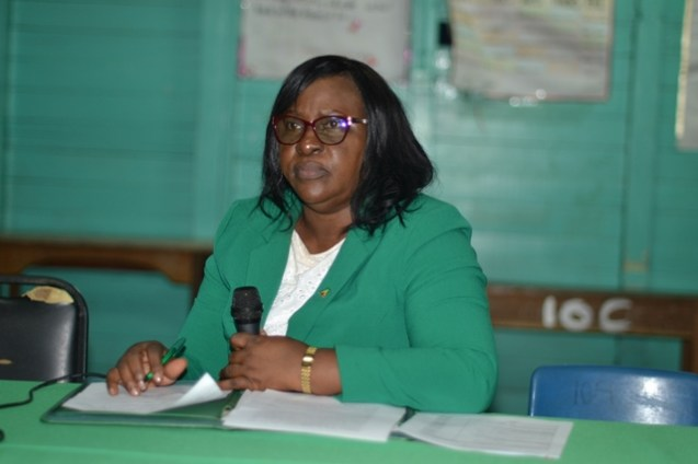 Minister within the Ministry of Public Health, Dr. Karen Cummings listens attentively as a resident of Manchester Village makes a point at a community meeting.