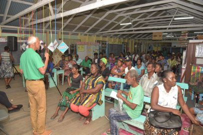 Minister of Communities, Ronald Bulkan addressing the residents of Wales and surrounding communities at the meeting.