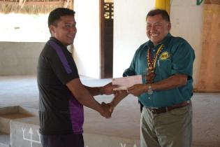 Another youth from the North Rupununi, Region 9 receiving his grant from Minister of Indigenous Peoples' Affairs, Sydney Allicock.