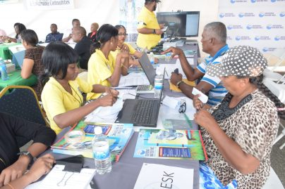 Person speaking with employees of the Guyana Water Incorporated (GWI).