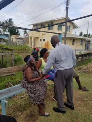 Minister Felix meeting residents during is walk-about in the community of Belladrum