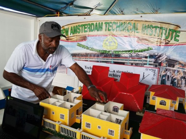 A tutor at the New Amsterdam Technical Institute explains his project.
