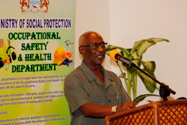 Minister within the Ministry of Social Protection, Keith Scott delivering remarks.
