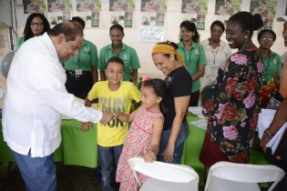 Prime Minister Nagamootoo greeted by a young resident of Region 6