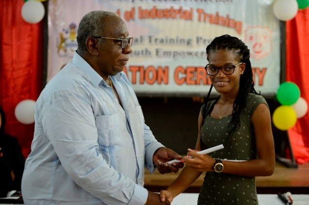 BIT Chairman, Clinton Williams handing out a certificate to one of the beneficiaries.