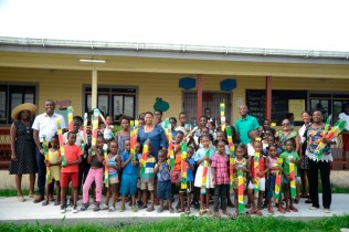 Minister of Public Health, Volda Lawrence and Deputy Mayor of Georgetown, Alfred Mentor [center] and National Chairman of the Guyana Youth and Student Movement (GYSM), Ryan Belgrave with the children as they display their kites.