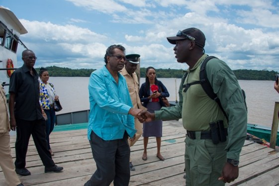 Minister of Public Security, Khemraj Ramjattan is greeted by Senior Superintendent of the Mazaruni Prison, Kevin Pilgrim on arrival at Mazaruni.