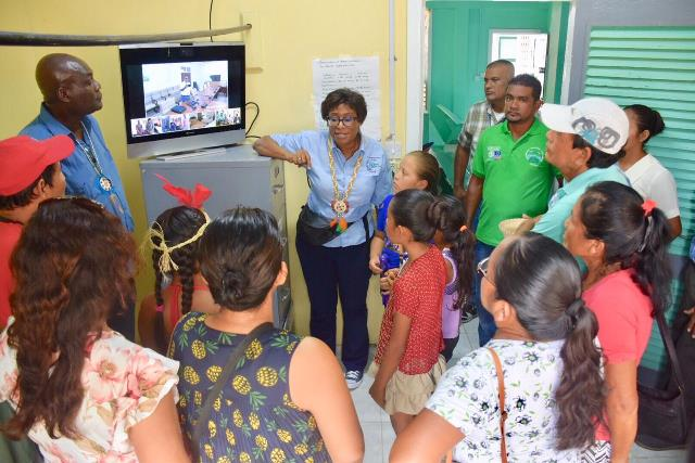 Minister of Public Telecommunications, Catherine Hughes explaining to the Orealla residents how they can now chat real-time with specialists across the country.