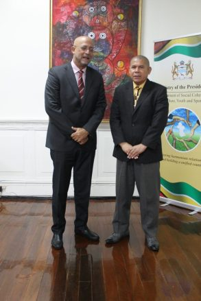 Minister of Social Cohesion with Responsibility for Culture, Youth and Sport, Dr. George Norton poses with President of Cricket West Indies, Richard Skerritt