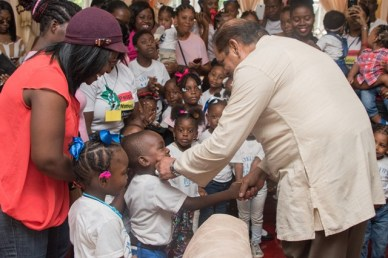 Prime Minister, Moses Nagamootoo, interacting with the children of Akelo ABC Playgroup and Daycare.