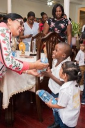Wife of the Prime Minister, Mrs. Sita Nagamootoo, distributing tokens to the children of Dorette's A to Z Preschool.