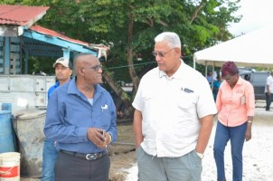 [In the photo, from left to right] Regional Chairman of Region 10, Renis Morian, Minister of Agriculture, Noel Holder.