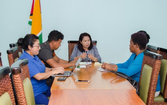 Minister of State, Dawn Hastings-Williams engaging Toshao of Chinese Landing, Orin Fernandes and members of the village council, and Rights Coordinator at the Amerindian Peoples' Association (APA), Laura George.