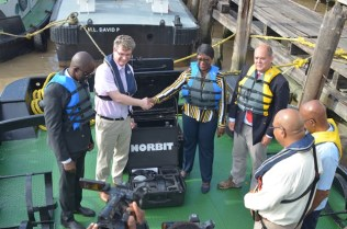 British High Commissioner to Guyana, Greg Quin hands over one of the sets of the hydrographic equipment to Director-General of the Maritime Administration Department, Claudette Rogers.