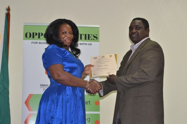 Tandica Hunte receiving her certificate from Chief Executive Officer (CEO) of the Small Business Bureau, Lowell Porter.