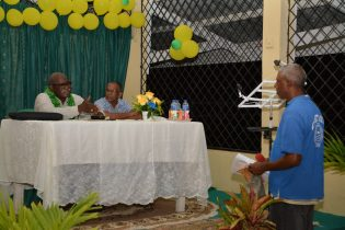Minister of Citizenship, Winston Felix listening to a resident