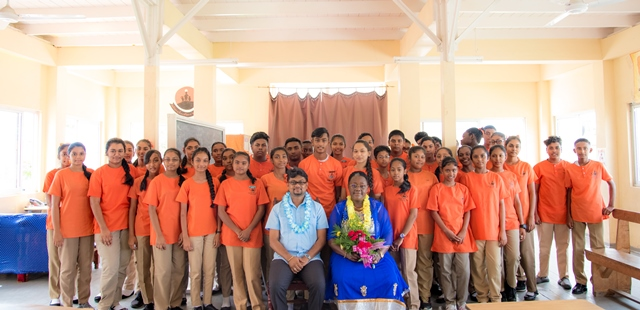 Minister with responsibility for Youth Affairs, Simona Broomes and Georgetown Mayor, Ubraj Narine posing with students.