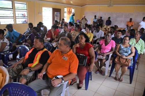 Port Kaituma residents await the start of government's mining lottery in their region.