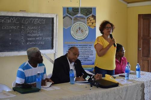 Minister within the Ministry of Indigenous Peoples Affairs, Valerie Garrido-Lowe, addresses residents of Port Kaituma during Friday's Mining Lottery. She is flanked by Minister of Natural Resources, Raphael Trotman [right] and Member of Parliament, Richard Allen and [left] by Acting GGMC Commissioner, Dianne Mc. Donald.