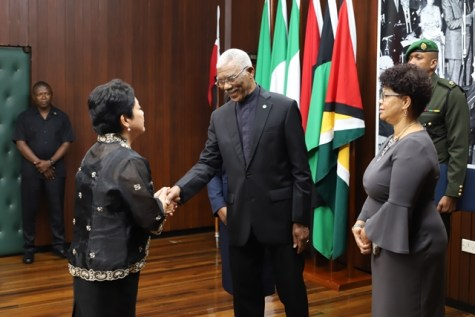 President David Granger being greeted by the new Philippine Ambassador to Guyana, Marichu Mauro.