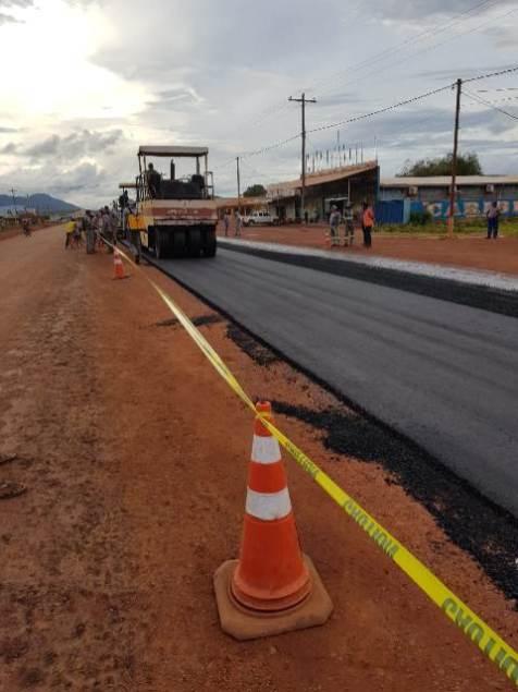 Asphalt paving begins on Lethem road, 100 metres of road selected for sample application of asphalt.