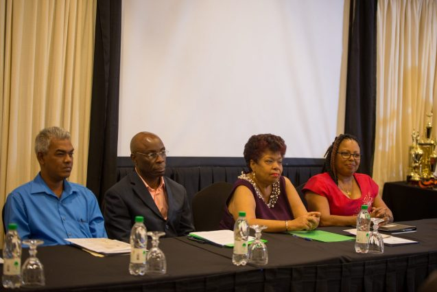 In the photo, from left to right] FITUG General Secretary, Dawshan Nagasar, NACOSH Chairman, Earl Morris, Minister of Social Protection, Amna Ally and NACOSH Vice Chairman, Patricia Woolford.