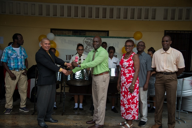 Presentation of Steel Pans to Tutorial High School. [in the photo from left] Headmaster (ag) of Tutorial High School, David Sam, Minister of Social Cohesion, Dr George Norton and teachers of Tutorial High.