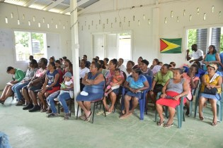 Byderabo residents attending a community meeting at the Multi-Purpose Building hosted by Minister of Public Security Khemraj Ramjattan, and Minister within the Ministry of Social Protection with responsibility for Labour, Keith Scott.