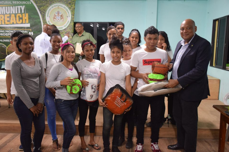 Minister of Natural Resources, Raphael Trotman hands over sports gear to youths