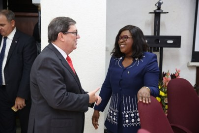 Cuba's Foreign Minister, Bruno Gonzalez Parrilla engaging with Guyana's Minister of Foreign Affairs, Dr. Karen Cummings.