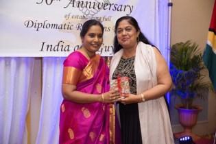 Mrs. Sita Nagamootoo presents a token of appreciation to Mrs. Mahalingam.
