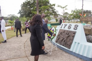 President of the Republic of Ghana, Nana Akufo-Addo places his floral tribute at the 1763 Monument. He is accompanied by Minister of Foreign Affairs, Dr. Karen Cummings and Vincent Alexander.