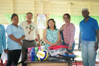Minister of Indigenous peoples' Affairs, Sydney Allicock and Minister of State, Dawn Hastings-Williams handing over the farming tools and sport gear to the residents of Canal Bank in the presence of Regional Member of Parliament (MP), Richard Allen.
