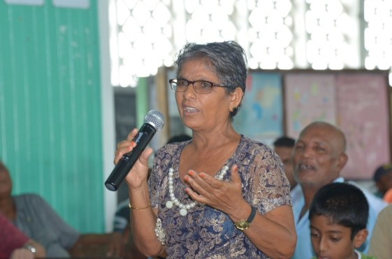 A resident makes a point during the community meeting