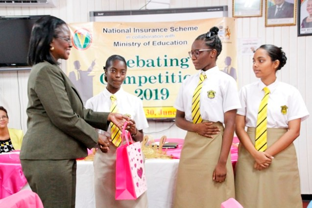 Second place winners of Queen's College receiving their prizes (Ministry of Education photo)