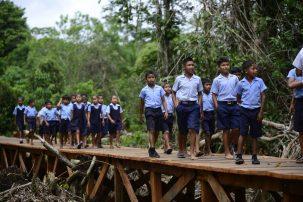 Students of the Yarshirmima Primary School traversing the bridge