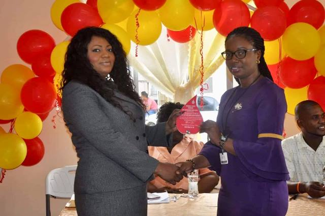 Chief Executive Officer, New Amsterdam Hospital, Dr. Samantha Kennedy hands over a plaque to a proud donor.