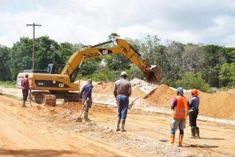 Construction workers preparing to complete the 1km portion of the Bartica-Potaro road.