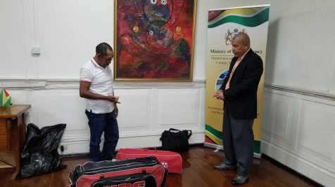 Minister Norton and Mr. Williams engage in conversation over the use of the cricket gears.